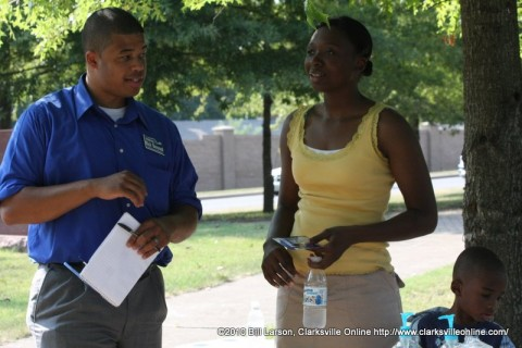 Nick Steward talks with a constituent in Patriots Park on Saturday