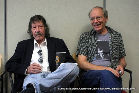 Michael White sitting next to author William Gay (left)