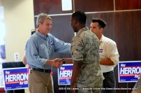 Roy Herron meeting an enlisted person before the event