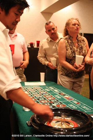 The Croupier launches the ball to kick off a round of roulette at A Night in Clarksvegas