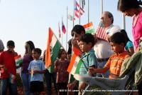Pravin Mehta (white shirt) leads the singing of the Indian National Anthem in McGregor Park.