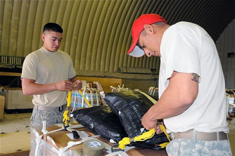 U.S. Army Staff Sgt. Carlos Gomez (right), noncommissioned officer-in-charge, Low-Cost Low-Altitude team, 626th Brigade Support Battalion, 3rd Brigade., 101st Airborne Division, and U.S. Army Pfc. Adam J. Garza, LCLA team member and native of Corpus Christi, Texas, attached to Co. A, 626th BSB, 3rd Brigade, 101st Airborne Div. (Photo by U.S. Army Sgt. Brent C. Powell, 3rd Brigade, 101st Airborne Division)