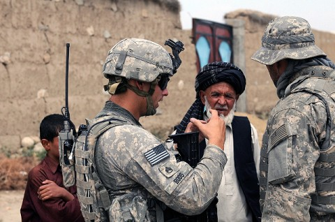 U.S. Army Staff Sgt. Jonathan Boos, discusses a possible well site with the Malik or village elder, of the village of Qaleh-Ye Mirza Jalal. The Soldiers conducted two key leader engagements and a presence patrol in the villages of Bajawri and Qaleh-Ye Mirza Jalal August 16th. During the engagements, U.S. Army 1st Lt. William Spears, a platoon leader from Chicago, and Boos, led discussions with the villages' Maliks. (Photo by U.S. Army Pfc. Roy Mercon, Task Force Wolverine Public Affairs, 86th Infantry Brigade Combat Team [Mountain])