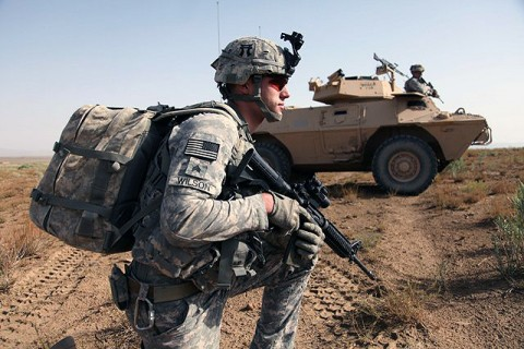 U.S. Army 2nd Lieutenant Phillip Divinski of Charlie Company, 3rd Battalion, 187th Infantry Regiment, 3rd Brigade, 101st Airborne Division, points to the next objective during a mission. (Photo by U.S. Army Sgt. Jeffrey Alexander/released)