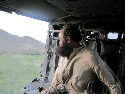 Afghan man looking out of helicopter (Photo by U.S. Army Staff Sgt. Sean Wright, Task force Red Knight)