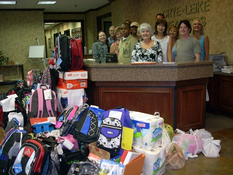 Crye-Leike Realtors and Employees presented more than 200 stuffed backpacks to the kids in Youth Villages's care at the company's Brentwood Regional Headquarters Office.  The backpacks and school supplies were donated by agents and employees from Crye-Leike offices across Middle Tennessee.