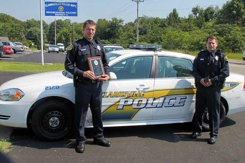 Left – Officer Sohn holding his Leadership Award Plaque, Right – Officer Leo Kryszewski