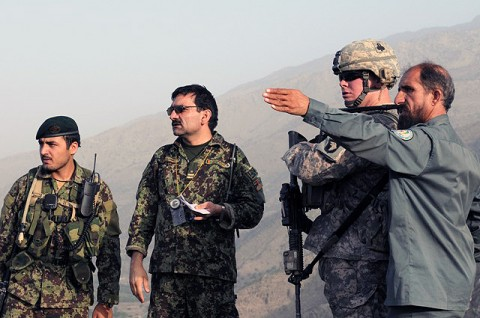 KUNAR PROVINCE, Afghanistan - From right, Afghan National Police Observation Post Rocky commander Syed Wali, U.S. Army Capt. Robert R. Reynolds of Huntsville, AL, and Afghan National Army Capt. Samad. (Photo by U.S. Army Staff Sgt. Gary A. Witte, 300th Mobile Public Affairs Detachment)