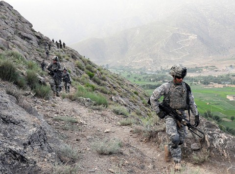 From right, U.S. Army Pfc. Edwin O. Crespo of Puerto Rico and Soldiers with 1st Platoon, Company A, 1st Battalion, 327th Infantry Regiment, Task Force Bulldog, climb a narrow trail to Observation Post Rocky here with Afghan National Army Soldiers July 19th. (Photo by U.S. Army Staff Sgt. Gary A. Witte, 300th Mobile Public Affairs Detachment)