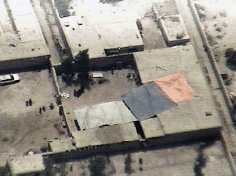 """An aerial view of the rocket impact location in village of Dam Abad. Insurgents fired three rockets at Forward Operation Base Salerno Aug. 14, missing the base. One rocket landed in the courtyard of a house, killing three children and wounding their mother. The rocket's impact crater is near the top of the courtyard, to the right of the tree. The children's deaths come just three days after the beginning of Afghanistan's most religious time of year, the month of Ramadan. Ramadan is an Islamic celebration held in honor of the month in which """"Allah"""" or """"God"""" revealed the Holy Quran to the Prophet Mohammed. (U.S. Army courtesy photo)"""