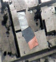 An aerial view of rocket impact location in village of Dam Abad. Insurgents fired three rockets at Forward Operation Base Salerno 14th August, which missed the base and landed in the courtyard of a house, killing three children and wounding their mother. The rocket's impact crater is on the right-hand side of the courtyard. The children's deaths come just three days after the beginning of Afghanistan's most religious time of year, the month of Ramadan. (U.S. Army courtesy photo)