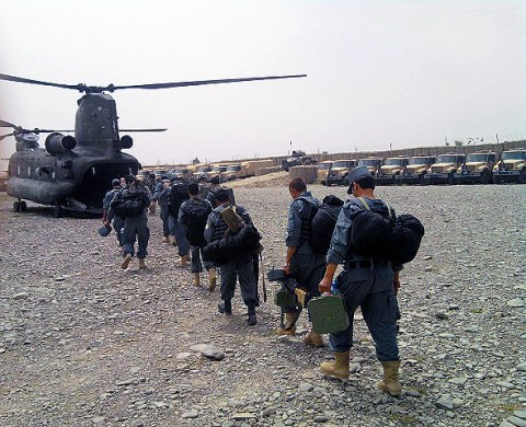 Afghan Uniformed Policemen line up to load onto CH-47 Chinook Helicopters prior to an air assault operation in support of Operation Shamshir in Ghazni Province August 2nd. (U.S. Army Courtesy Photo)
