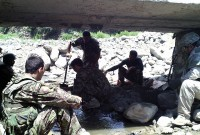 The 2nd Brigade, 201st Corps Afghan National Army Engineers continue repairs on the Dab Bridge August 8th in eastern Afghanistan's Kunar province. The bridge was damaged during a flood and limited military and civilian transportation. (Photo by U.S. Army Staff Sgt. Thomas White, Task Force Bastogne)
