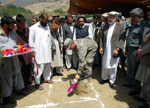 U.S. Navy Lt. Cmdr. Paul Wewers, stationed at Tinker Air Force Base, OK, Kunar PRT executive officer, participates in the ground breaking ceremony for the Asadabad orphanage July 15th. (Photo by U.S. Air Force 1st Lt. Amy Abbott, Kunar Provincial Reconstruction Team)