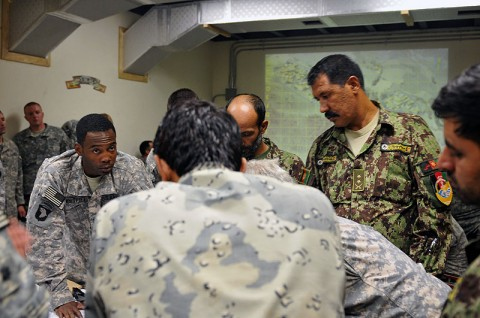 U.S. Army Capt. Thomas Whitfield, of Fort Campbell, KY, the company commander of Company B, 2nd Battalion, 327th Infantry Regiment, Task Force No Slack, reviews tactical details of Operation Strong Eagle II with Afghan National Security Forces commanders at Forward Operating Base Joyce, July 18th. Capt. Whitfield's company was the lead element during the operation. The goal of the operation was to clear insurgents from the village of Chenar, deny them safe haven and extend the reach of reach of Government of the Islamic Republic of Afghanistan. The operation took place in the Ghaki Valley in eastern Afghanistan's Kunar province and involved approximately 425 Coalition Forces. (Photo by U.S. Army Spc. Albert L. Kelley, 300th Mobile Public Affairs Detachment)