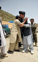 Khost provincial Gov. Abdul Jabar Naeemi is welcomed by Spera village elders and sub-government officials prior to a shura at the Spera District Center, Khost province, Afghanistan, July 25th. (U.S. Army Photo by Pfc. Chris McKenna, 3rd Brigade Combat Team)