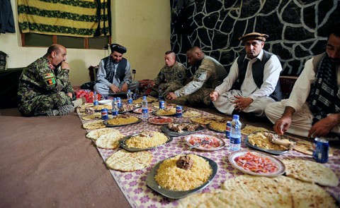Khost Provincial Gov. Abdul Jabar Naeemi, U.S. Army Lt. Col. Stephen Lutsky, 1st Squadron, 33rd Cavalry Regiment commander, and U.S. Navy Commander Dave Billingslea, Khost Provincial Reconstruction Team commander, eat together at the conclusion of a shura in the Spera District Center, Khost province, Afghanistan, July 25th. (U.S. Army Photo by Pfc. Chris McKenna, 3rd Brigade Combat Team)