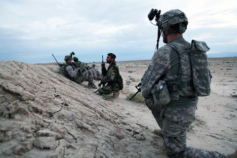 Rakkasan Soldiers from Company C, 3rd Battalion, 187th Infantry Regiment, 101st Airborne Division, and Afghan National Army soldiers from the 3rd Kandak, 3rd Brigade, 203rd Corps stop to take a break during a joint mission as part of Operation Tabar V in Ghazni Province August 8th. (Photo by U.S. Army Spc. Lorenzo D. Ware, 982nd Combat Camera Company)