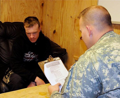 U.S. Army Sgt. Ryan M. Lahr (right), a native of Estherville, IA, and certified occupational therapy assistant, Mild Traumatic Brain Injury Clinic, 626th Brigade Support Battalion, 3rd Brigade, 101st Airborne Division, administers a cognitive memory test to U.S. Army Spc. Steven J. Smith. (Photo by U.S. Army Sgt. Brent C. Powell, 3rd Brigade, 101st Airborne Division)