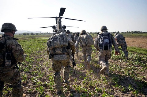 U.S. Army Soldiers with the Focused Tactical Force, 3rd Brigade Combat Team, 101st Airborne Division, run towards a CH-47 helicopter following an air-assault operation in Bak, Khost Province, Afghanistan July 7th.  (Photo by U.S. Army Pfc. Chris McKenna, 3rd Brigade Combat Team)