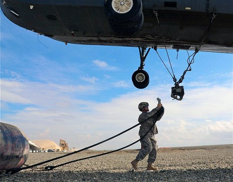 U.S. Army Sgt. Patricia A. Oconnell, a native of Clarksville, TN,  and assigned to Company A, 626th Brigade Support Battalion, 3rd Brigade, 101st Airborne Division, prepares to attach a 500-gallon collapsible fuel bladder to the bottom of a helicopter at Forward Operating Base Sharana here Aug. 7th. Oconnell is the noncommissioned officer in charge of the helicopter landing zone. (Photo by U.S. Army Sgt. Brent C. Powell, 3rd Brigade, 101st Airborne Division)