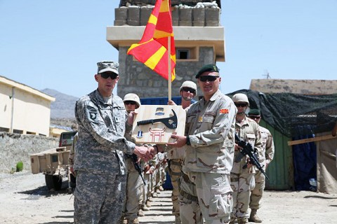 U.S. Army Lt. Col. David Fivecoat, presents Macedonian Capt. Borche Turturov, commander of the Macedonia army rangers from Skopje, Macedonia, with an award of appreciation during a celebration of the Macedonia army's 18th birthday on Combat Outpost Shar Hawza, Paktika Province Aug. 18th. This event was coordinated by Task Force Iron Rakkasans on Foward Operating Base Sharana. (Photo by U.S. Army Spc. Lorenzo Ware, 982nd Combat Camera Co.)