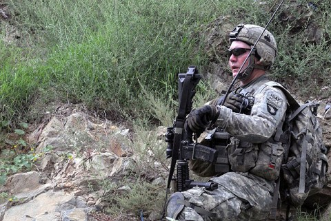U.S. Army 1st Sgt. Kenneth L. Bolin of Cincinnati, OH, the first sergeant for Company A, 2nd Battalion, 327th Infantry Regiment, Task Force No Slack, directs fire against the enemy during an Aug. 18th attack against troops visiting the village of Spinkay in eastern Afghanistan's Kunar Province. (Photo by U.S. Army Staff Sgt. Gary A. Witte, 300th Mobile Public Affairs Detachment)
