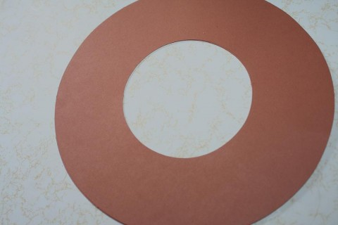 Start with a large circle cut out of brown paper