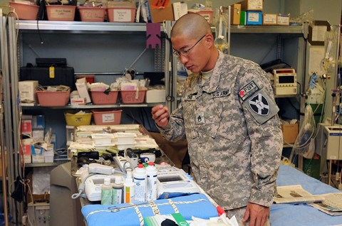U.S. Army Staff Sgt. Benjamin Chou, a native of Salt Lake City, the non commissioned officer in charge of the Advanced Trauma Life Support section of the 934th Forward Surgical Team, inspects medical instruments prior to receiving patients at Forward Operating Base Sharana Sept. 9th. (U.S. Air Force photo by Master Sgt. Demetrius Lester)