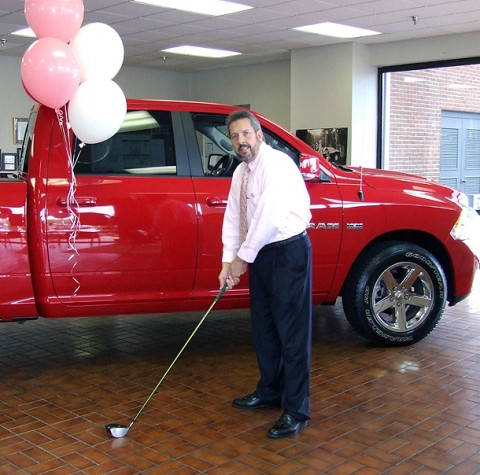 """David """"Elvis"""" Feltman tees up in preparation for the 16th annual Gary Mathews Motors Golf Scramble, """"Scramble FORE a Cure"""", Sept. 26th at Swan Lake Golf Course.  This year's beneficiary of the proceeds will be Breast Cancer Awareness."""