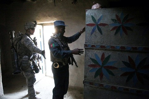 Afghan Uniform Police and U.S. Army Soldiers with the 3rd Battalion, 320th Field Artillery Regiment, 3rd Brigade Combat Team's Focused Tactical Force search a building during dismounted operations in Khost Province. (U.S. Army courtesy photo)
