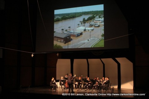 The Gateway Chamber Ensemble playing Mozart to a slideshow of flood photos