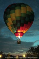 The hot air ballon rises skywards above the Adventure Zone on Friday Evening at the 2010 Riverfest celebration.