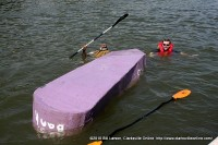 The crew of the CHS boat after it capsized along side the dock.