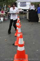 A young woman runs the obstacle course during Wait Staff Wars