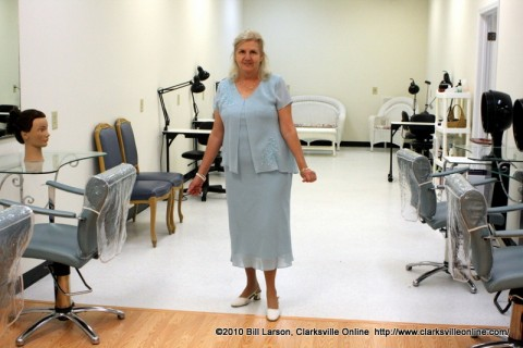 Linda Austin shows off her newly reconstructed Salon area at Austin's Beauty School's grand reopening