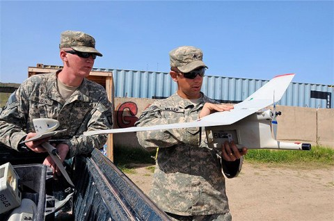 U.S. Army Sgt. Justin Miller attaches the wings to a Raven remotely piloted aircraft Sept. 14th as U.S. Army Pfc. Charles Hanson, rifleman, Co. A, 1st Bn., 187th Inf. Reg., a native of Spartanburg, SC, looks on. The Soldiers use the RPA to provide aerial surveillance and reconnaissance for the company commander when needed. (Photo by U.S. Army Sgt. Brent C. Powell, 3rd Brigade, 101st Airborne Division)