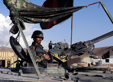 An Afghan National Army soldier stands guard at Forward Operating Base Thunder, one of three bases insurgents attacked in eastern Afghanistan Sept. 24th. (Photo by U.S. Army Staff Sgt. Troy P. Johnson, 304th Public Affairs Detachment)