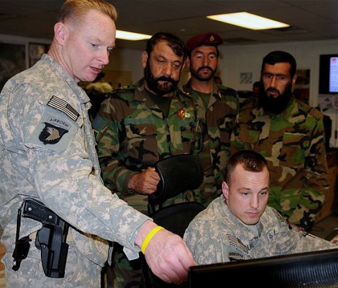 U.S. Army Maj. Mark Leslie (left), operations officer and native of Chattanooga, TN, 3rd Brigade, 101st Airborne Division, and Staff Sgt. Mitchell Burns, battle captain and native of Tioga, LA, 3rd Bde., 101st Abn. Div., show Afghan National Army commando leaders points of interest on a computer screen at the brigade's tactical operations center Sept. 18th. (Photo by U.S. Army Sgt. Brent C. Powell, 3rd Brigade, 101st Airborne Division)