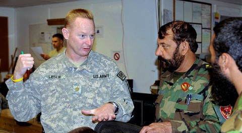 U.S. Army Maj. Mark Leslie, operations officer and native of Chattanooga, TN, 3rd Brigade, 101st Airborne Division, explains the brigade's intelligence operations to Afghan National Army commandos at the brigade's tactical operations center Sept. 18th. (Photo by U.S. Army Sgt. Brent C. Powell, 3rd Brigade, 101st Airborne Division)
