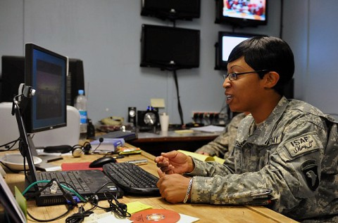 U.S. Army Sgt. Dianne T. Peele, of Portsmouth, VA, a human resources manager with Headquarters and Headquarters Company, 1st Brigade Combat Team, Task Force Bastogne, participates in an online chat session with a teenage female Afghan students in the city of Jalalabad in eastern Afghanistan's Nangarhar Province Sept. 21st. (Photo by U.S. Army Sgt. Albert L. Kelley, 300th Mobile Public Affairs Detachment)