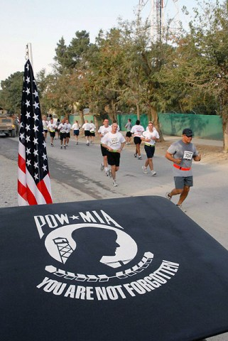 Deployed servicemembers and civilians honor 9/11 by participating in the Patriot Day Run here Sept. 11th. More than 2,200 deployed servicemembers and civilians ran 9.11 km in remembrance of the 9/11 attacks. (Photo by U.S. Army Capt. Michelle Lunato, 359th Theater Tactical Signal Brigade)