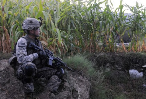 U.S. Army Pfc. Dustin Wade of Mulberry, FL, a rifleman with 1st Platoon, Company A, 1st Battalion, 327th Infantry Regiment, Task Force Bulldog, provides security for his platoon outside the village of Angla Kala in eastern Afghanistan's Kunar Province Sept. 16th. (Photo by U.S. Army Staff Sgt. Gary A. Witte, 300th Mobile Public Affairs Detachment)
