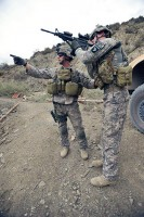 U.S. Army Spc. Jared Goodwin, a medic with Troop A, 1st Squadron, 33rd Cavalry Regiment, 3rd Brigade Combat Team, directs U.S. Army Pfc. Josh Lanehart, a driver with Troop A, 1st Squadron, 33rd Cavalry Regiment, 3rd BCT, to pull security toward high ground during dismounted operations. (Photo by U.S. Army Pfc. Chris McKenna, 3rd Brigade Combat Team Public Affairs)