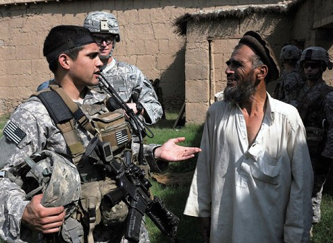 U.S. Army 1st Lt. James D. Horne of Fayetteville, NC, a platoon leader with Company A, 2nd Battalion, 327th Infantry Regiment, Task Force No Slack, talks to a resident of Lar Sholtan village in eastern Afghanistan's Kunar province Aug. 21st.  (Photo by U.S. Army Staff Sgt. Gary A. Witte, 300th Mobile Public Affairs Detachment)