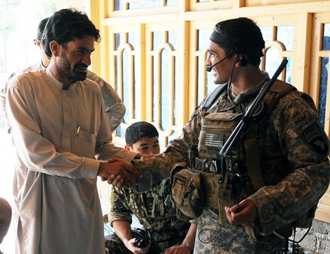 U.S. Army 1st Lt. James D. Horne of Fayetteville, NC, a platoon leader with Company A, 2nd Battalion, 327th Infantry Regiment, Task Force No Slack, shakes hands with a resident of Lar Sholtan village in eastern Afghanistan's Kunar province Aug. 21st. (Photo by U.S. Army Staff Sgt. Gary A. Witte, 300th Mobile Public Affairs Detachment)