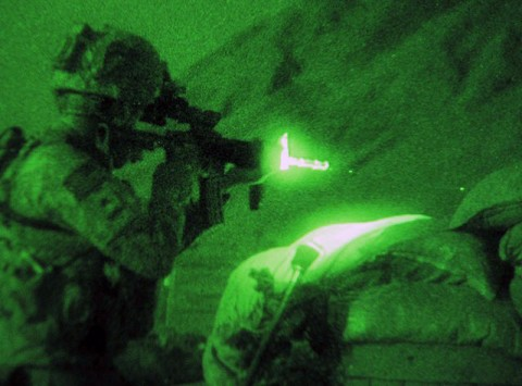 U.S. Army Sgt. George R. Rueda of Norwalk, CA., weapons squad leader with 1st Platoon, Company B, 2nd Battalion, 327th Infantry Regiment, Task Force No Slack, aims his weapon using an infrared laser sight during an insurgent attack on Combat Outpost Badel. (Photo by U.S. Army Staff Sgt. Gary A. Witte, 300th Mobile Public Affairs Detachment)