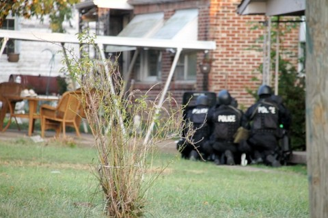 Tactical team members waiting for the suspect to come out of the house