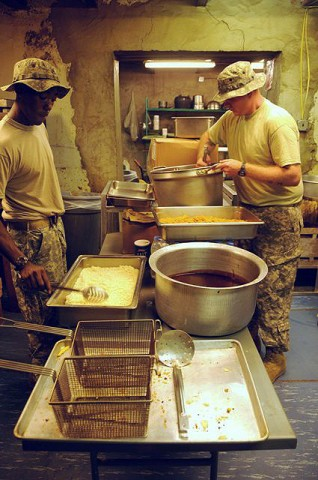 U.S. Army Sgt. Timothy Hunnicutt from Atlanta, and U.S. Army Pvt. Clayton C. Hilderbrand from Ceres, VA, prepare rice and noodles for dinner for Soldiers stationed at Forward Operating Base Tillman here Sept. 10th. (Photo by U.S. Army Spc. Luther L. Boothe Jr., Task Force Currahee Public Affairs, 4th Brigade Combat Team, 101st Airborne Division)