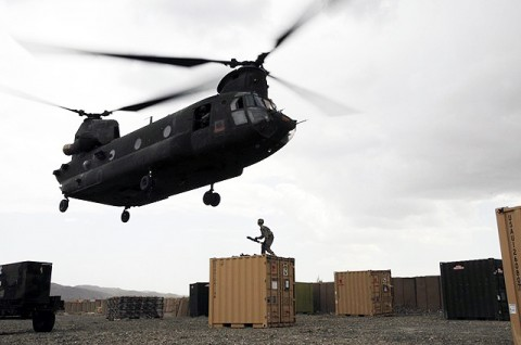 U.S. Army Pvt. Philip C. Brosch, 4th Brigade Combat Team, 101st Airborne Division, braces himself as he prepares to hook up a supply container to a CH-47 Chinook helicopter at Forward Operating Base Orgun-E Sept. 10th. (Photo by U.S. Army Spc. Luther L. Boothe Jr., Task Force Currahee Public Affairs, 4th Brigade Combat Team, 101st Airborne Division)
